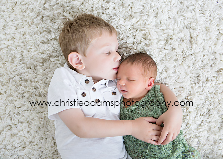 If you are expecting a baby later this spring or summer be sure to book your newborn session well in advance christie adams photography established in